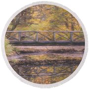 A Walking Bridge Reflection On Peaceful Flowing Water. Round Beach Towel
