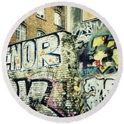 A Wall Of Berlin With Graffiti Round Beach Towel
