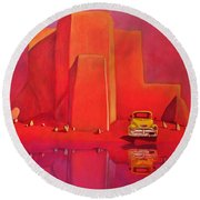 A Yellow Truck With A Red Moon In Ranchos Round Beach Towel