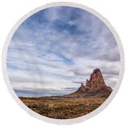 Round Beach Towel featuring the photograph Agathla Wakes Up by Jon Glaser