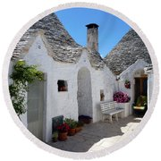 Alberobello Courtyard With Trulli Round Beach Towel