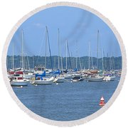 Round Beach Towel featuring the photograph All In Line by Newwwman