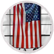 Round Beach Towel featuring the photograph American Flag In The Window by Mike McGlothlen