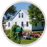 Round Beach Towel featuring the photograph Amish House With Mums by Cricket Hackmann