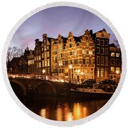 Round Beach Towel featuring the photograph Amsterdam Canal Houses With Reflection At Dusk by IPics Photography