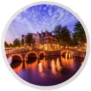 Round Beach Towel featuring the photograph Amsterdam Idyllic Nightscape From Keizersgracht And Leidsegracht  by Melanie Viola