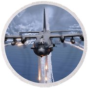 An Ac-130h Gunship Aircraft Jettisons Round Beach Towel
