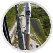 An Atlas V Rocket On The Launch Pad Round Beach Towel