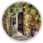 Round Beach Towel featuring the photograph An Entrance In Santorini by Tom Prendergast