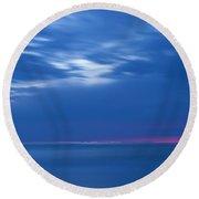 An Icy Blue Sea At Dawn Round Beach Towel
