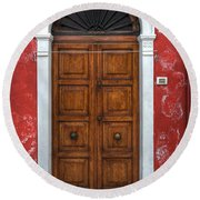 an old wooden door in Italy Round Beach Towel