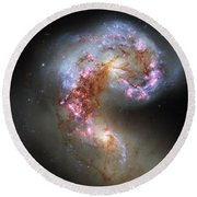 Round Beach Towel featuring the photograph Antennae Galaxies Reloaded by Nasa