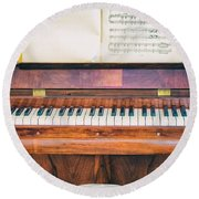 Round Beach Towel featuring the photograph Antique Piano And Music Sheet by Silvia Ganora