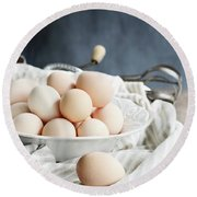 Apron And Eggs On Wooden Table Round Beach Towel