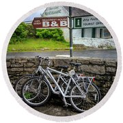 Round Beach Towel featuring the photograph Aran Island Bicycles by Craig J Satterlee
