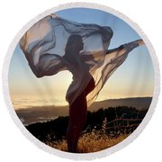 As The Wind Carries The Flower Of A New Life Round Beach Towel