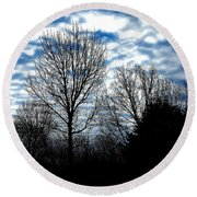 Ash Trees Against A Mackerel Sky Round Beach Towel
