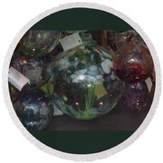 Round Beach Towel featuring the photograph Assorted Witching Balls by Suzanne Gaff