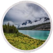 At The End Of Spray Lake Round Beach Towel