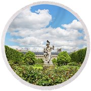 At The Palais Royal Gardens Round Beach Towel by Melanie Alexandra Price