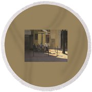 At The Street Cafe Round Beach Towel