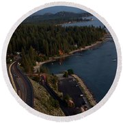 atop Cave Rock Round Beach Towel by Brad Scott
