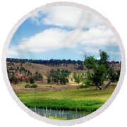 August At Wyoming Devils Tower With With Cowboy Panorama 01 Round Beach Towel