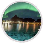 Aurora Above Turquoise Waters Round Beach Towel by Alex Conu