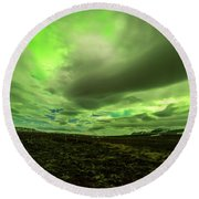 Aurora Borealis Over A Frozen Lake Round Beach Towel by Joe Belanger