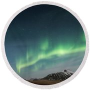 Round Beach Towel featuring the photograph Aurora Borealis Over Iceland by Sandra Bronstein