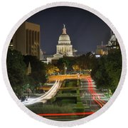 Round Beach Towel featuring the photograph Austin Light Trails by Tim Stanley