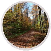 Round Beach Towel featuring the photograph Autumn Woods Road by Rick Morgan