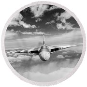 Round Beach Towel featuring the digital art Avro Vulcan Head On Above Clouds by Gary Eason