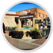 Back Alley View Of The Gaslight Inn Patio Round Beach Towel by Charles Ables