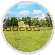 Baled Hay In A Grassy Field Round Beach Towel