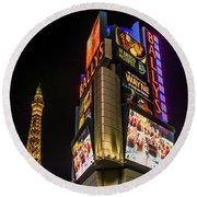 Round Beach Towel featuring the photograph Ballys Sign In Front Of The Eiffel Tower At Night by Aloha Art