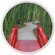 Round Beach Towel featuring the photograph Bamboo Path Through A Red Bridge by Raphael Lopez