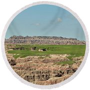 Badlands Panorama Round Beach Towel by Nancy Landry