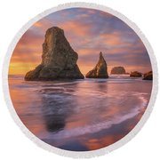 Round Beach Towel featuring the photograph Bandon's New Years Eve Light Show by Darren White