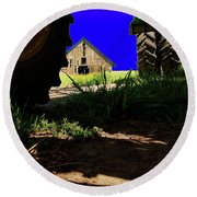 Round Beach Towel featuring the photograph Barn From Under The Equipment by Bob Cournoyer