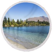 Beach In Queenstown, New Zealand Round Beach Towel