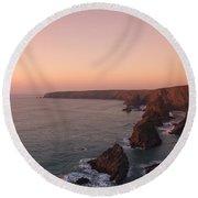 Bedruthan Steps Sunset Round Beach Towel by Helen Northcott