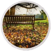 Round Beach Towel featuring the photograph Bench With Autumn Leaves by Gary Gillette