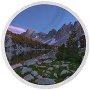Between A Rock And A Soft Place Round Beach Towel