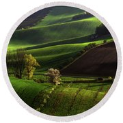 Round Beach Towel featuring the photograph Between Green Waves by Jenny Rainbow
