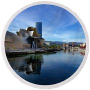 Bilbao In Autumn With Blue Skies Next To The River Nervion Round Beach Towel