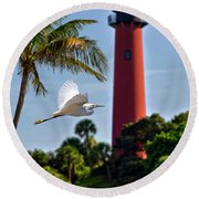 Bird In Flight Under Jupiter Lighthouse, Florida Round Beach Towel by Justin Kelefas