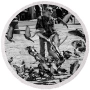 Black And White Of Boy Feeding Pigeons In Sarajevo, Bosnia And Herzegovina  Round Beach Towel