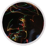 Round Beach Towel featuring the photograph Blizzard Of Colorful Lights. Dancing Lights Series by Ausra Huntington nee Paulauskaite