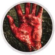 Blood Stained Hand Coming Out Of The Ground At Night Round Beach Towel